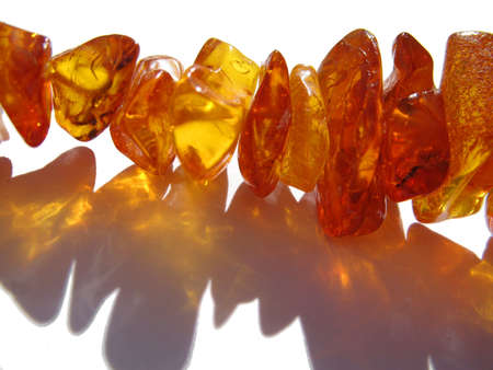 amber beads dropping shadows Stock Photo