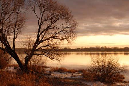 sunset on river photo