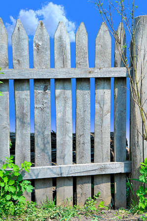 Natural wooden fence and blue sky