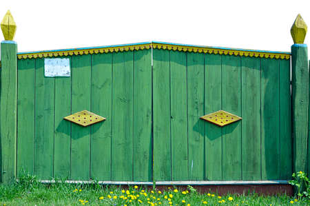 Old village gate with the elements of screw-thread, painted in a green color Stock Photo