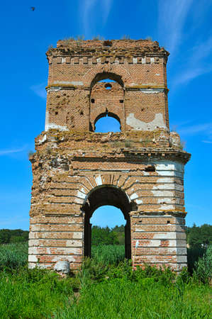 The blasted bell tower of old temple of the flooded village is in the aquatorium of kanevskoe reservoir