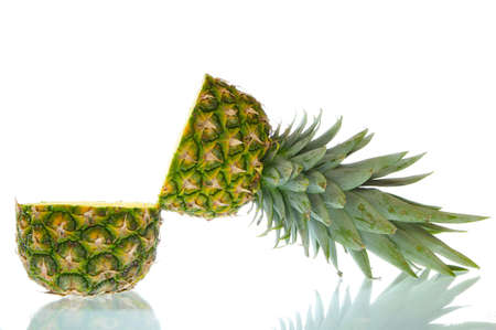 Open pineapple with reflections isolated on a white background.