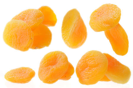A close up of few dried apricots isolated on white