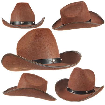 vaquero: Conjunto de un sombrero de vaquero marr�n sobre fondo blanco.  Foto de archivo