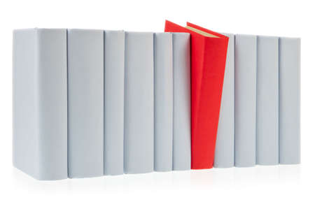 Red book falls out of row of grey books