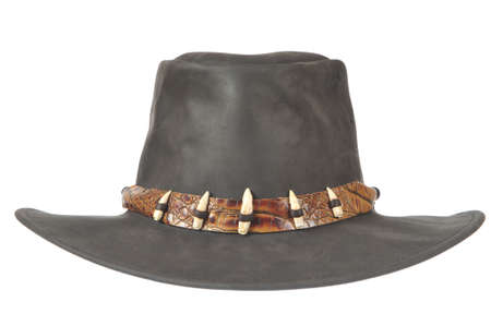 dandy: A black cowboy hat with crocodale teeth in front on white background. Stock Photo