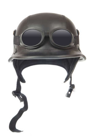 Old-fashioned motorcycle helmet with goggles, isolated on white