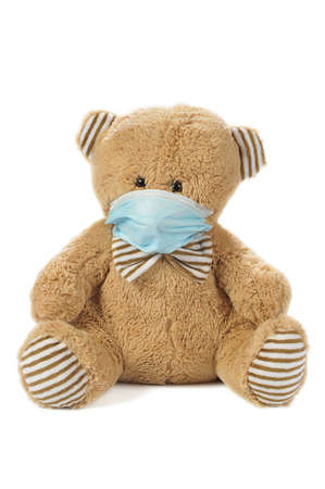 Image of a stuffed bear in madical mask isolated on white