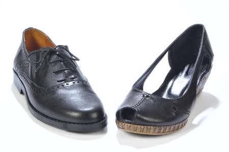 One mile shoe and one female shoe isolated on white background photo