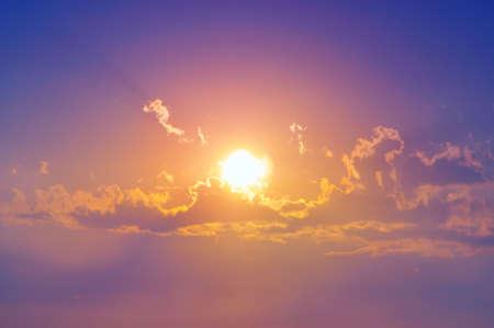 A sunburst shining through the clouds.
