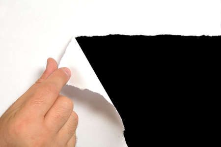 cut or torn paper: Torn white paper with black background
