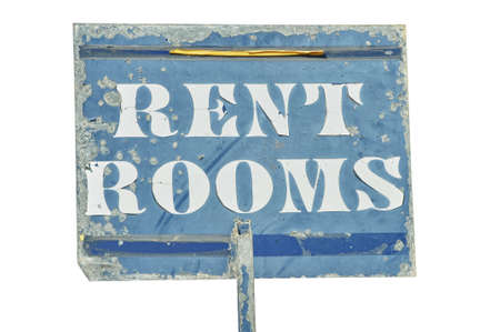 housing problems: Shabby metal sign with the text RENT ROOMS