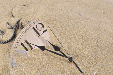 Analog Wall Clock buried under the sand