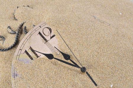 clocks: Analog Wall Clock buried under the sand