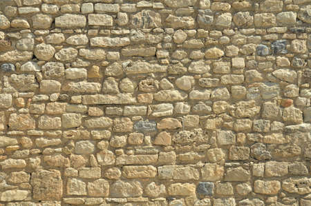 Antique stone wall of Ruins of the Minoan Knossos Palace background