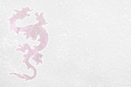Photography of a fiery dragon on a frozen window. Symbol of new year.