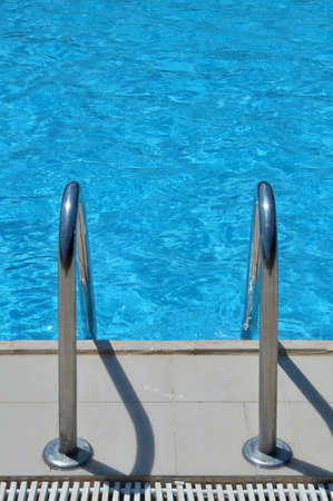 The steps into a swimming pool