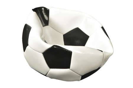 A traditional black and white new deflated soccer ball isolated on white studio background  Stock Photo