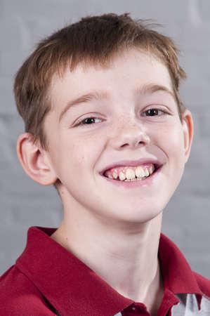 Portrait of smiling boy 10 years. Studio shoot.