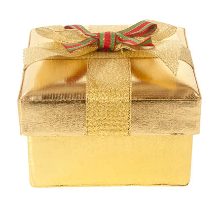 Closed gold gift box with bow and ribbon on a white background