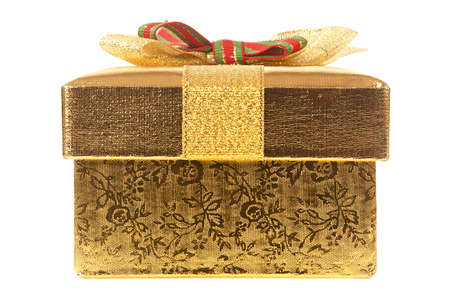 Front View Of Closed gold gift box with bow and ribbon on a white background.