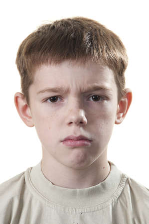 elementary age boy: Cute boy anger isolated on a white background