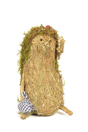 handmade hedgehog of hay and moss, isolated on white background Stock Photo