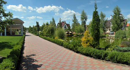 paved walkway parkland in luxury cottage town