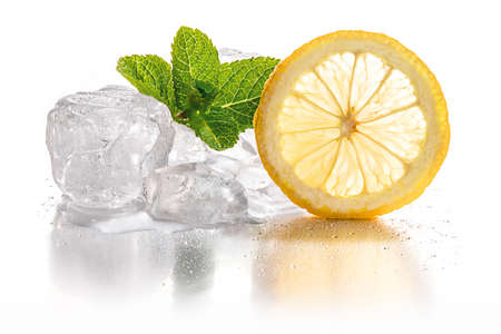 Ice cubes and slice of lemon with mint leaf on white background Stock Photo