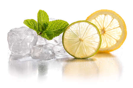 Ice cubes and slice of lemon and lime with mint leaf on white background