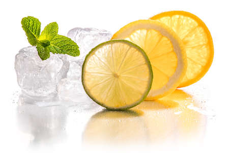 Ice cubes and slice of lemon, lime and orange with mint leaf on white background