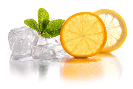 Ice cubes and slice of lemon, and orange with mint leaf on white background