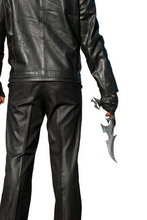Man in black with an ancient knife on a white background Stock Photo
