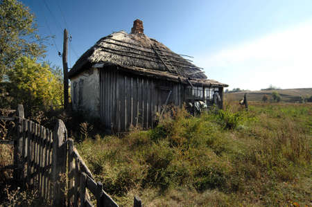 Deserted house with thatched roof in the village photo