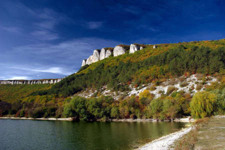 tranquille: Autumn scene at lake in high mountains of Crimea Stock Photo