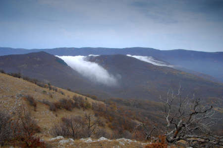 Summit of mountain with view of clouds Stock Photo