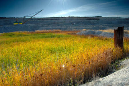 pit fall: Opencast mine with view of lake Stock Photo