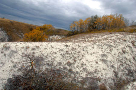 Autumn on hills with dramatic clouds