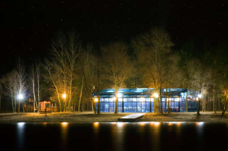 Glass building in the night under star sky Stock Photo