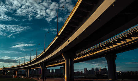 Highway overpass in Kazan, Russia, under view of the concrete pillars. The concept of urbanization.