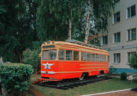 Vintage Soviet tram among greenery in Perm, Russia.
