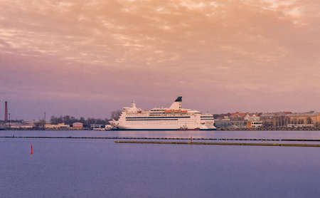 Passenger ferry in the Port of Riga. The big cruise liner near to embankment at sunset. Standard-Bild