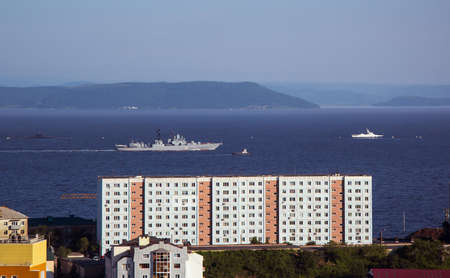 Soviet residential building by the sea. Warships at sea. The Far East, view of the Amur Bay. Banco de Imagens