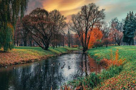 Marupite River in Riga Victory Park. Autumn landscape with trees and river. Magnificent landscape.