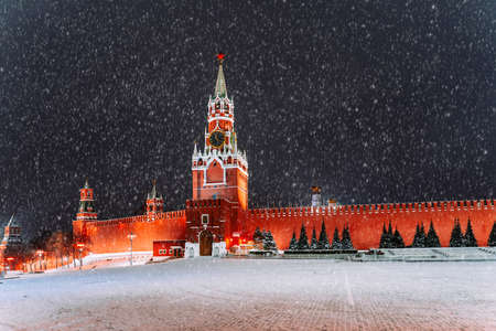 Empty Red Square without people. Snowy winter view. Spasskaya Tower and the Kremlin wall