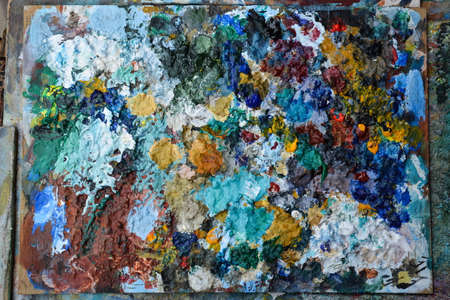 color mixing: The artists palette with colored paints Stock Photo