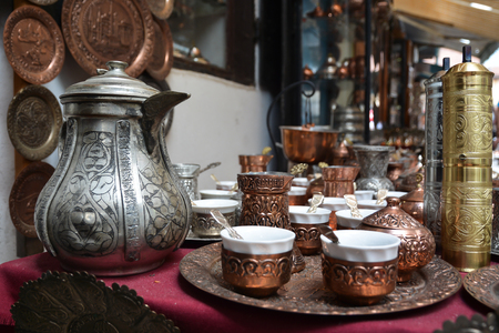 chased: Copper cookware for tea, decorated with chased pattern.