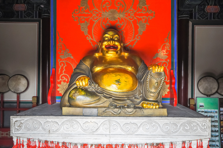 plenitude: God of happiness Hotei in the temple. Stock Photo