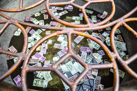 capacitance: Banknotes, abandoned for luck in the water.