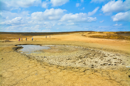 Tourists in the valley of mud volcanoes. Stock Photo